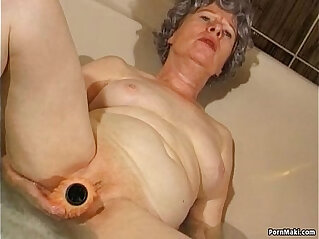 Granny masturbates with vibrator in bathtub