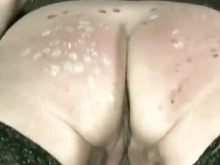 Master spanks slave on her with candle wax covered ass